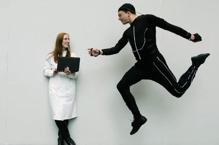 Man jumping in air next to woman