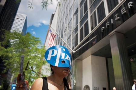 Woman protesting outside Pfizer offices