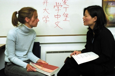 Teacher speaking with a student