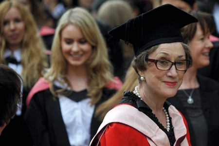 Dame Carol Black with female university graduates