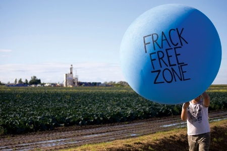 Man holding 'Frack Free Zone' balloon
