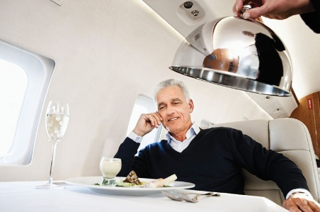 Businessman served food on airplane