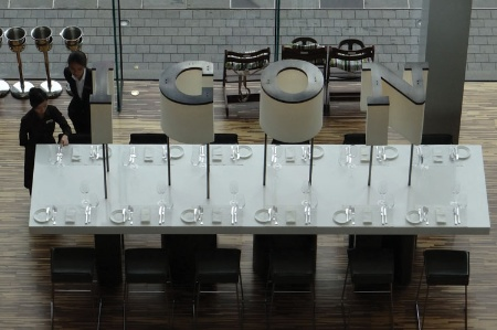 Waitresses setting places at Hotel ICON dining table