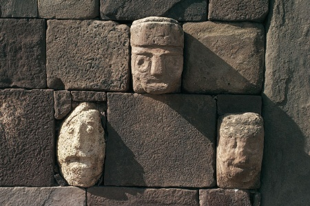 Stone heads fitted to wall at Tiwanaku