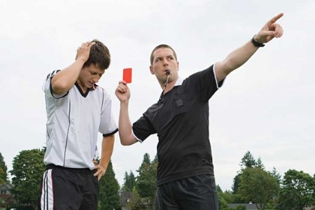 Referee giving player a red card