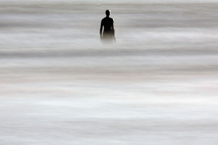 Silhouette standing in sea