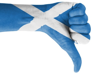 Hand with thumb down painted with Scottish flag