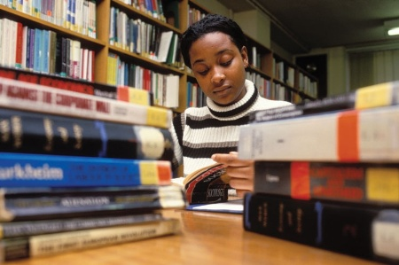 Female student reading in library