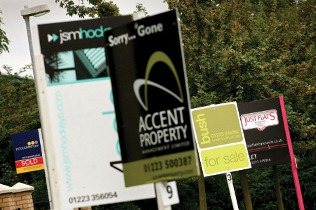 Estate agent 'For sale' and 'To let' signs