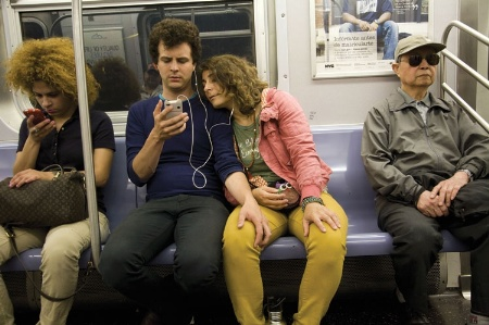 People using smartphones on subway