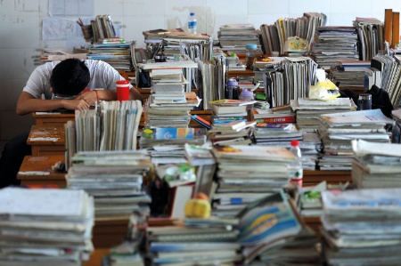 Chinese student surrounded by books