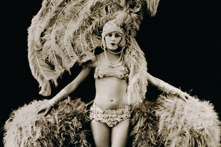 Young female dancer dressed in feathers
