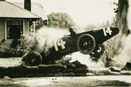 Sepia photo of racing car crash
