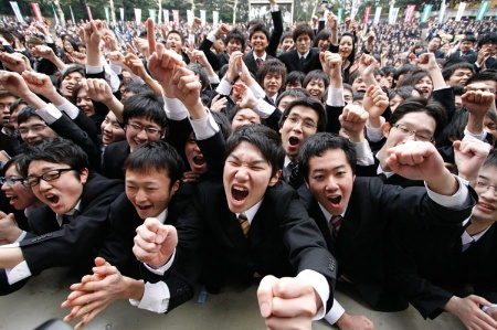 Crowd of male students cheering