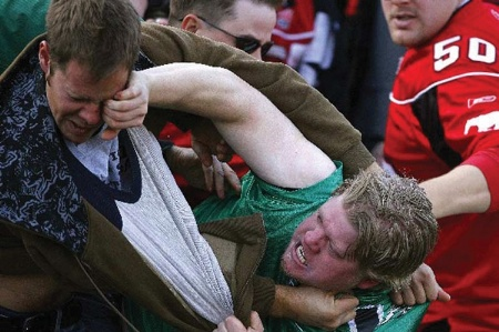 Football hooligans fighting