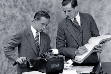 Two male accountants working (black and white)