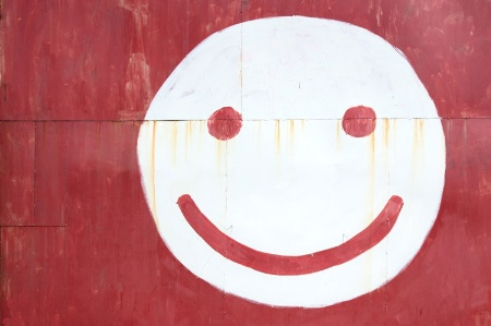 National Student Survey 2014 results, smiley face painted on red wall