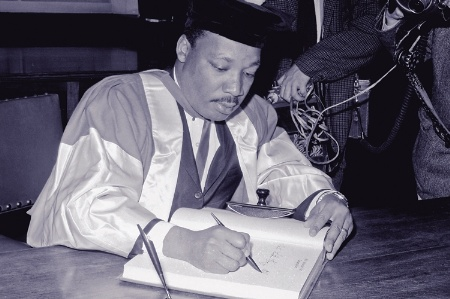 Martin Luther King signs a register at Newcastle University