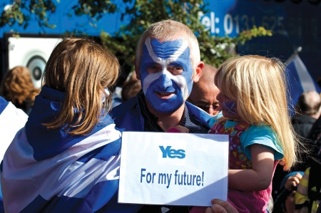 Man with Scottish flag painted on face