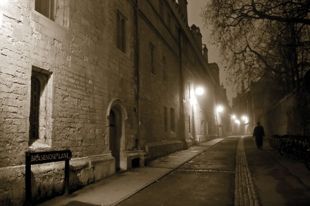 Man walking down Brasenose Lane, Oxford, at-night