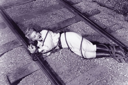 Woman tied up on train tracks
