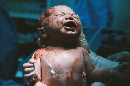 Newborn baby in hospital delivery room