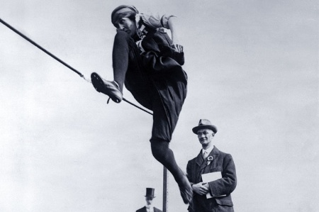 Woman performing high jump