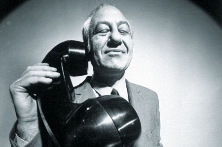 Man using huge telephone receiver