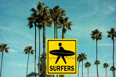 'Surfers' sign in front of palm trees