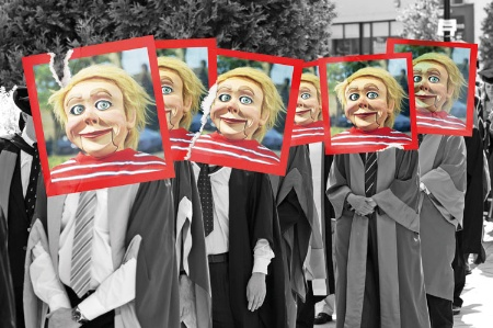 Queue of university graduates with puppet heads photos pasted over faces