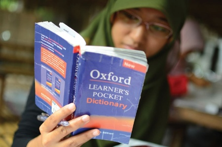 Indonesian woman reading English dictionary