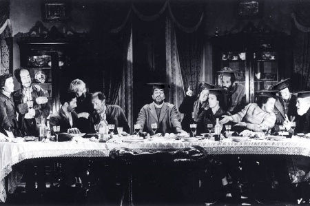 People sitting at dining table (black and white)