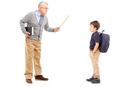 Teacher disciplining schoolboy