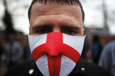 A man wearing a mask with the England flag on it