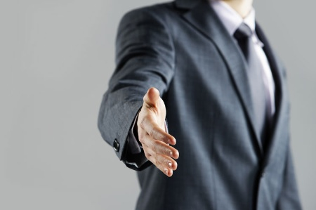 Businessman extending hand