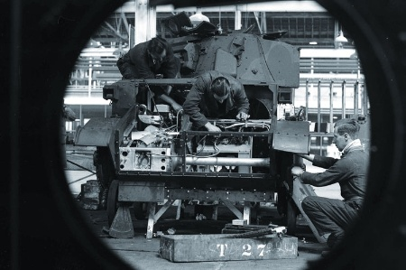 Men working on army tank