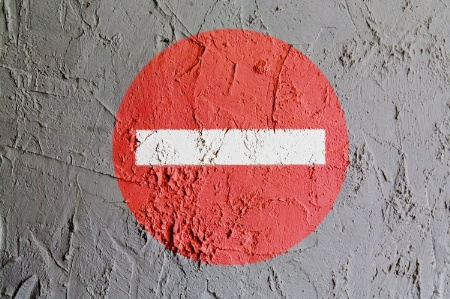 'No entry' sign painted on a wall