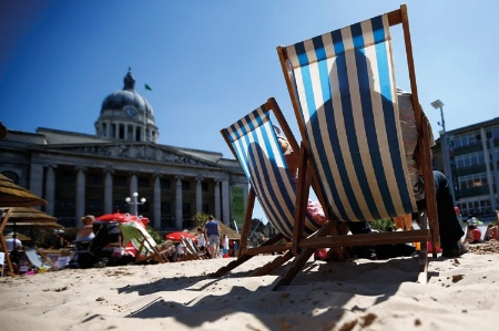 People sitting in deckchairs on man made beach