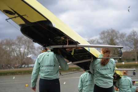 Cambridge rowers carrying boat