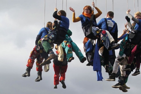Group of abseilers hanging from lines