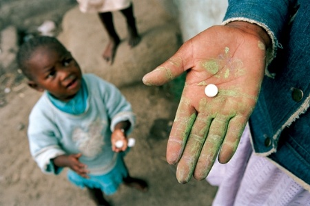 African child with pill
