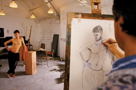 Male model being drawn by an artist