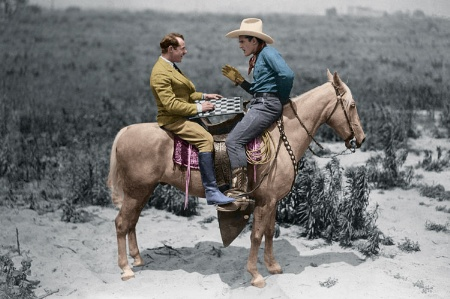 Two men playing checkers on back of horse