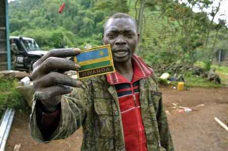 Rwandan man holding shoulder patch