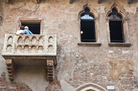People posing for photograph on Italian balcony