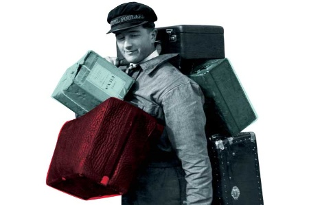 Hotel porter laden with luggage