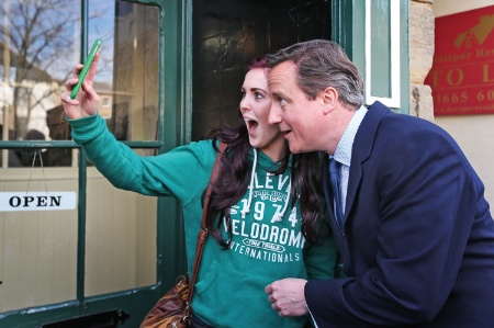Girl taking a selfie with David Cameron