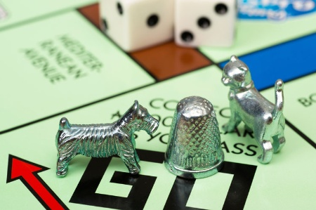Monopoly pieces, board and dice