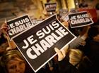 Charlie Hebdo shootings: crowd holding 'Je Suis Charlie' signs