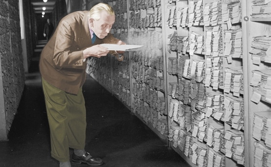 A humourous picture of a man searching a large and dusty archive